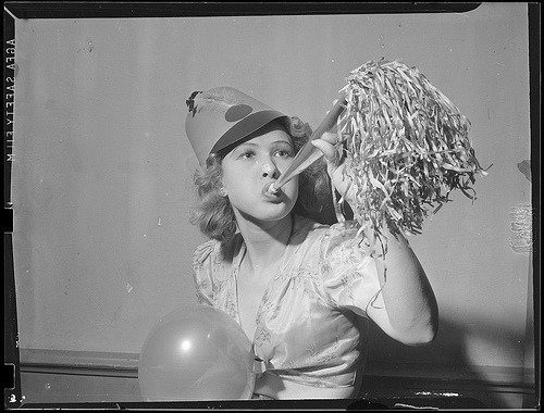 Woman with Party Horn and Party Hat